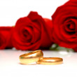 Rings and red roses — Stock Photo #1371185
