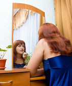 Woman tints lips — Stock Photo