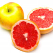 Постер, плакат: Red grapefruit and yellow apple