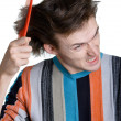 Young man with the hairbrush — Foto Stock