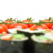 Постер, плакат: Japanese sushi and red tomatoes