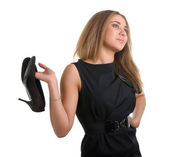 Girl holds shoes — Stock Photo