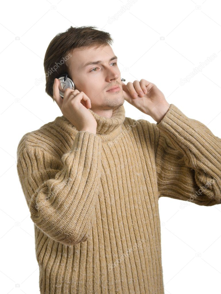 Young men in ear-phones listens to music. Isolation on a white background. — Stock Photo #1438688
