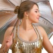 Young women with a silver umbrella — Stock Photo #1440212