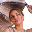 Women in golden dress with umbrella — Stock Photo #1577858