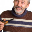Elderly surprised man with a pipe — Stock Photo