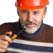 Stock Photo: Elderly men in a red building helmet