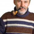 Adult man with a pipe in a hand — Stock Photo