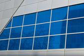 Blue windows reflecting street — Stock Photo