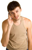 Young talking men with cellular phone — Stock Photo