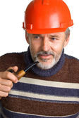 Elderly men in a red building helmet — Stock Photo