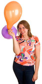 Joyful woman with balloons — Stok fotoğraf