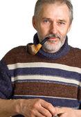 Adulte homme avec une pipe dans une main — Photo