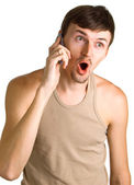 Young surprised men with cellular phone — Stock Photo