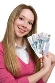 Girl with money and credit card on hands — Stock Photo