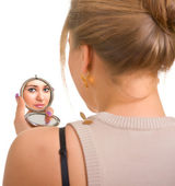 Women looks in a mirror — Stock Photo