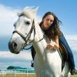 Stock Photo: Serenity young girl astride horse