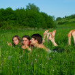 Girls lay in a green summer grass — Stock Photo #1601304