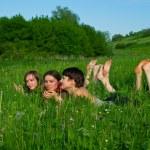 Girls lay in a green summer grass — Stock Photo #1601304