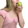 Girl with a green apple — Stock Photo #1608297
