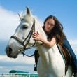 Stock Photo: Girl astride horse