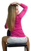 Girl sits on a chair — Stock Photo
