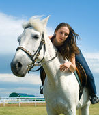 Serenity young girl astride a horse — Stock Photo