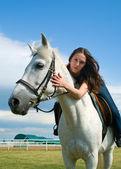 Girl astride a horse — Stock Photo