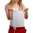 Young girl shows empty sheet — Stock Photo #1632862