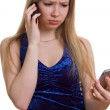 Sad girl with two cellular — Stock Photo #1633399