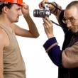 Elderly photographer and young builder — Stock Photo