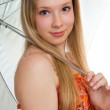 Young smiling girl with a umbrella — Stock Photo #1633624