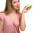 Beautiful girl with a green apple — Stock Photo