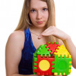 Beautiful girl holds the toy house — Stock Photo