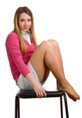 Smiling girl sits on a chair — Stock Photo