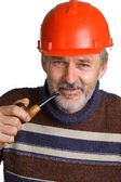 Smiling men in a red building helmet — Stock Photo