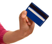 Blue credit card in a female hand — Stockfoto