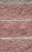 Red stone wall background — Stock Photo