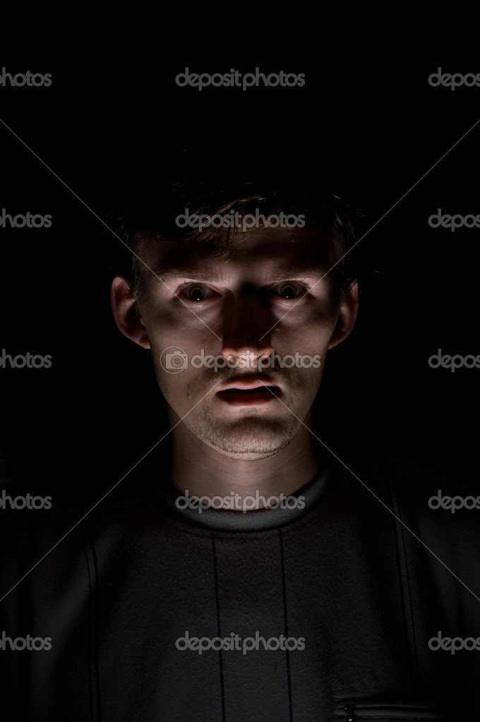 Portrait of the gloomy caucasian men on the black background — Stock Photo #1630063