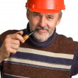 Men in a red building helmet — Foto Stock