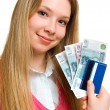Smiling girl with money and credit card — Stock Photo