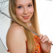Young smiling girl with a umbrella — Stock Photo #1989887