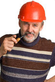 Men in a red building helmet — Stock Photo