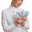 Young smiling girl holds money in hand — Stock Photo #1991021