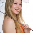 Smiling girl with a umbrella — Stock Photo #1991546