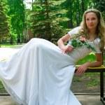 Bride in a white wedding dress — Stock Photo