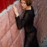 Girl in black dress at ladder — Stock Photo #1998431