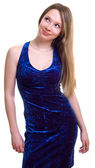 Beautiful girl in a dark blue dress — Stock Photo