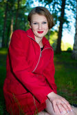 Smiling women in red raincoat — Stock Photo