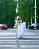 Beautiful bride passes road — Stock Photo